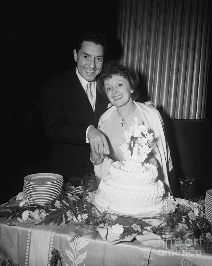 Edith Piaf Cuts Wedding Cake Photograph by Bettmann