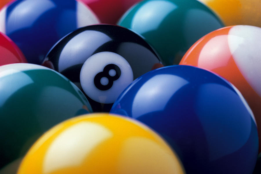 Eight Ball Among Other Billiard Balls Photograph by Comstock