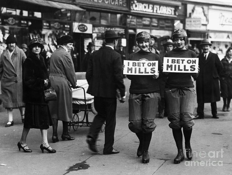 Election Bet Losers Walking With Signs Photograph by Bettmann