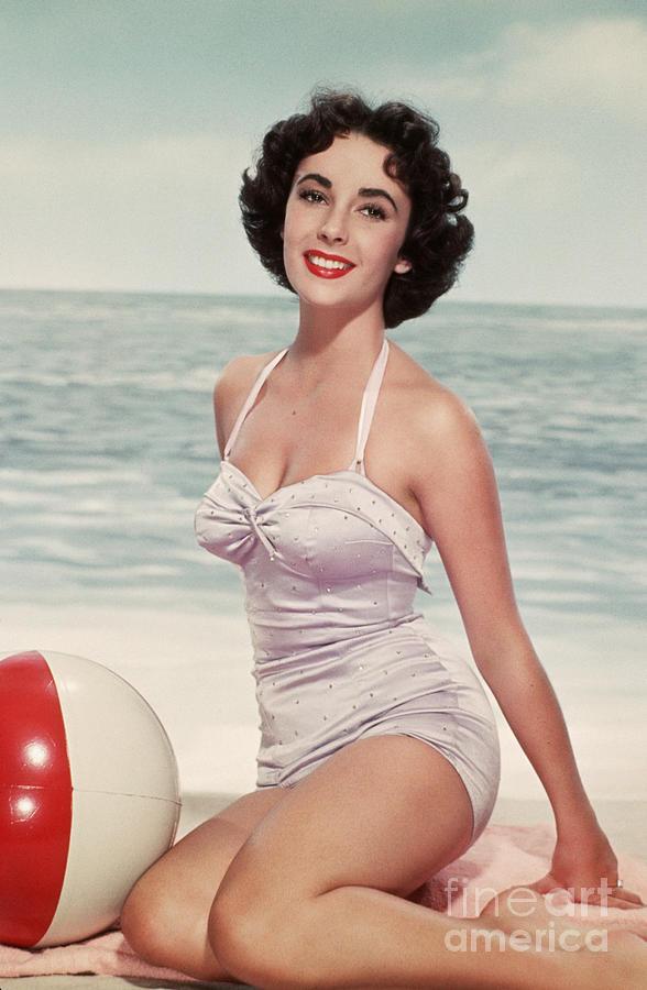 Elizabeth Taylor In A Bathing Suit Photograph by Bettmann