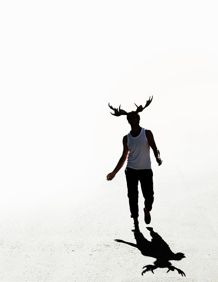 Elk Man Walking Photograph by Maskot