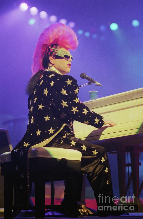 Rock Music Photograph - Elton John Performs With Mohawk Hairdo by Bettmann