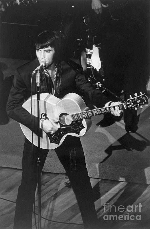 Elvis Presley Playing Guitar And Singing Photograph by Bettmann