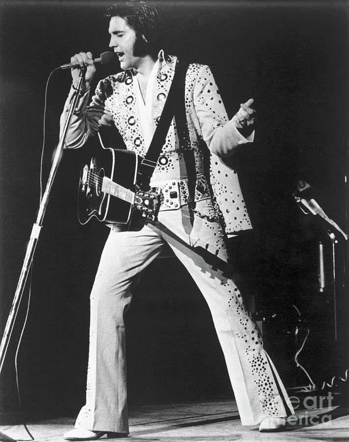 Elvis Presley Singing In Concert Photograph by Bettmann