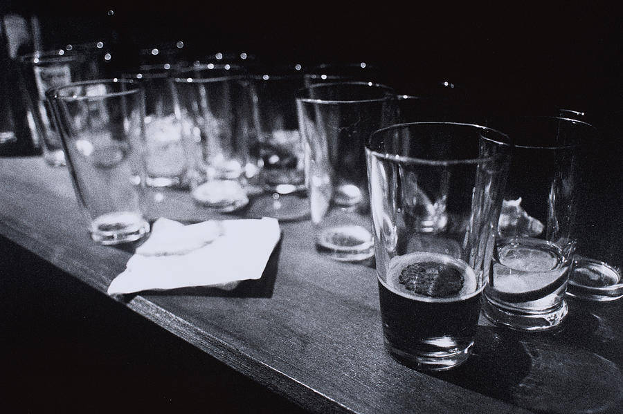 Empty Beer Glasses On Table Photograph by Henry Horenstein