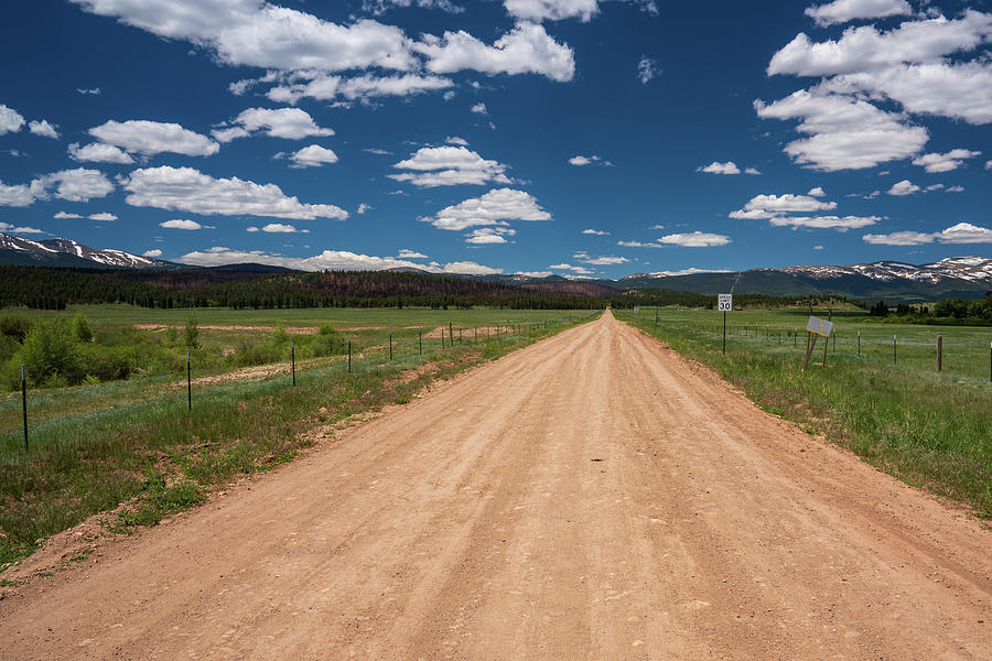Empty dirt road in Colorado by Kyle Lee