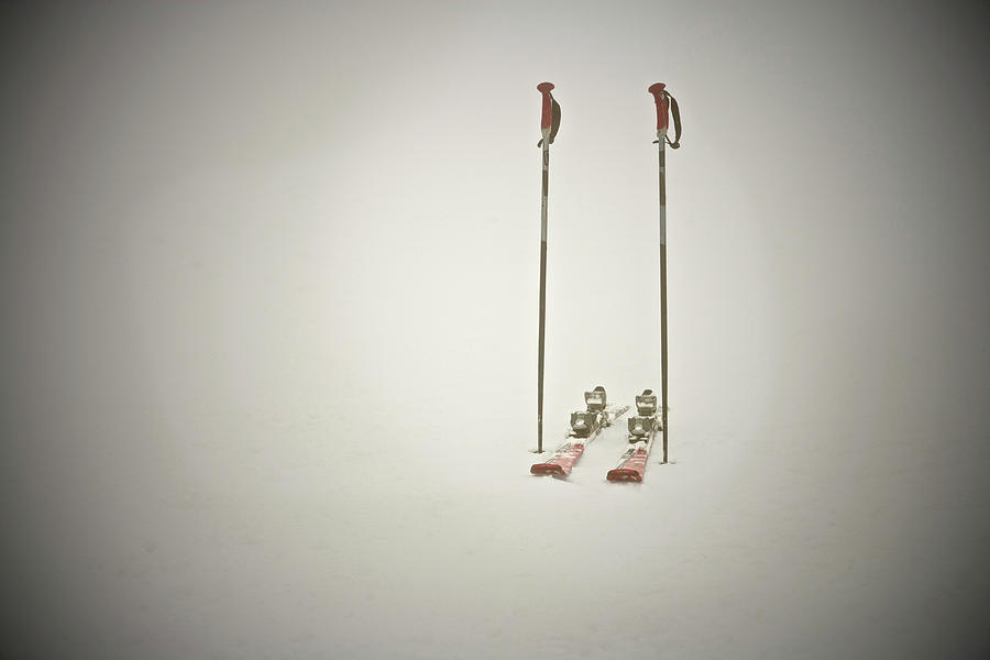 Empty Skis And Poles In Snow Photograph by Ross Woodhall