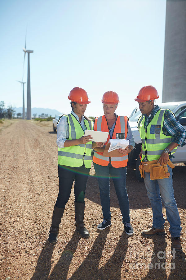 Alternative Energy Photograph - Engineer And Workers Using Digital Tablet by Caia Image/science Photo Library