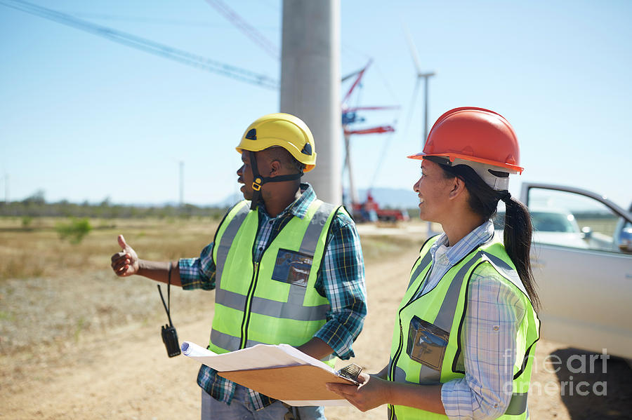 African Photograph - Engineers With Blueprints Talking At Sunny Power Plant by Caia Image/science Photo Library