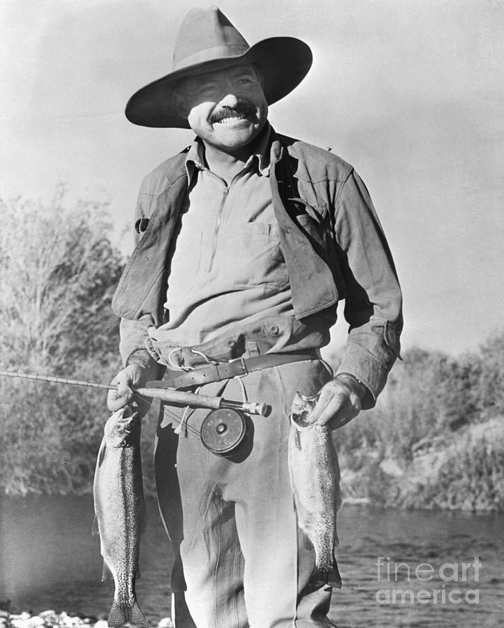 Ernest Hemingway Holding Fish Photograph by Bettmann