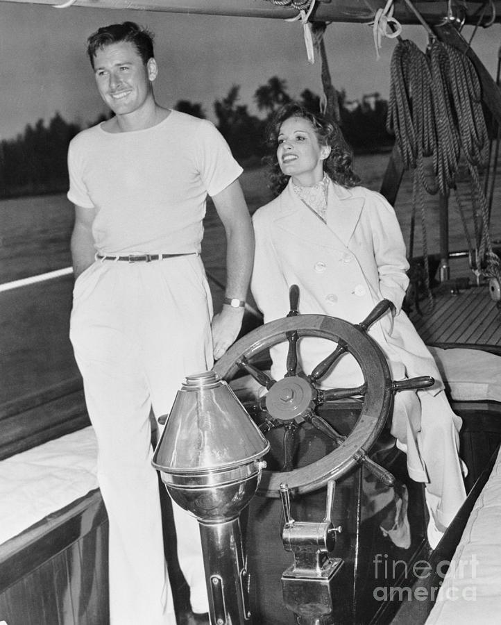 Errol Flynn And Lili Damita On Fishing Photograph by Bettmann