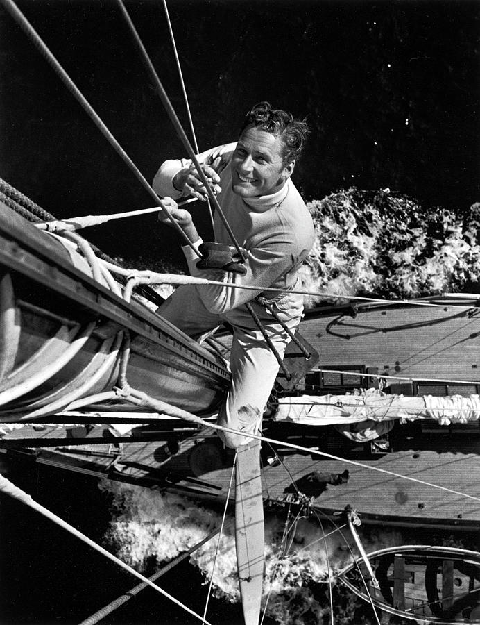 Errol Flynn Climbs The Mast Photograph by Peter Stackpole
