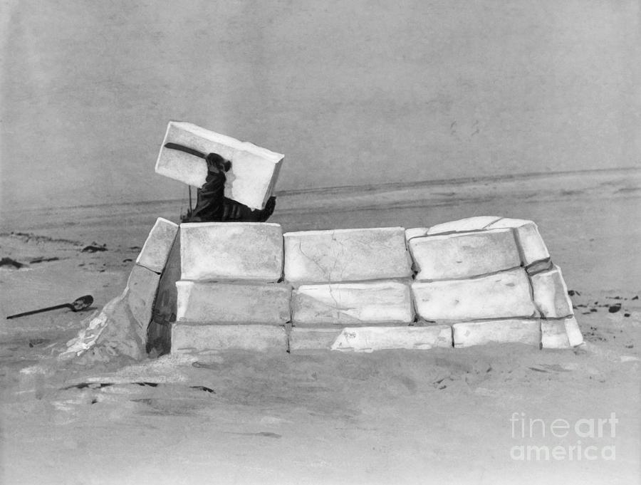 Eskimo Building An Igloo Photograph by Bettmann