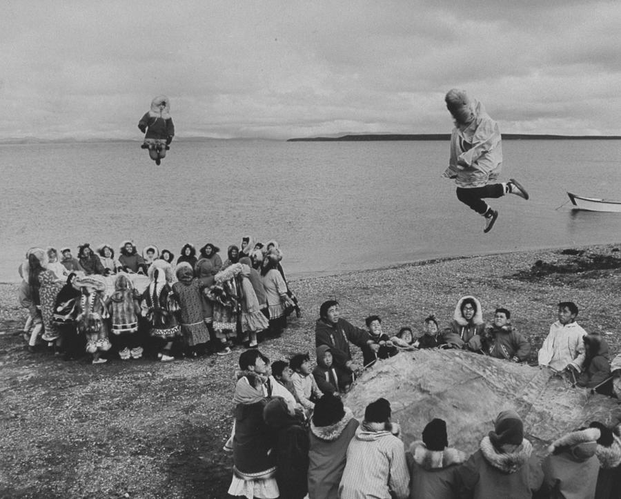 Eskimos Using Homemade Trampolines To Ce Photograph by Ralph Crane