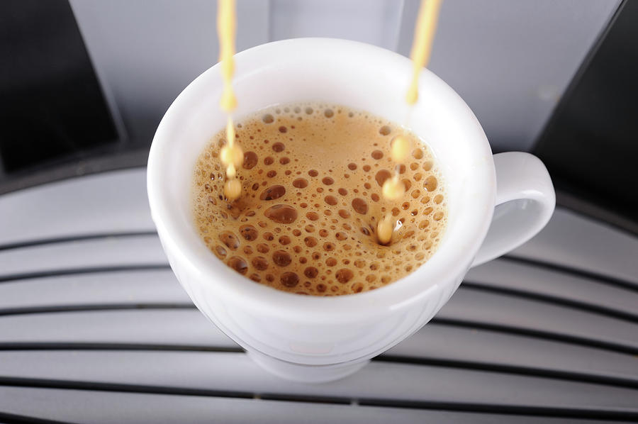 Espresso Pouring Into Cup Photograph by Gm Stock Films