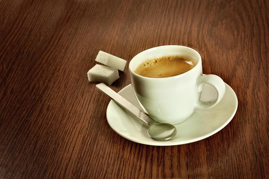 Espresso With Sugar Lumps Photograph by Stefano Oppo