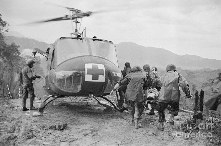 Evacuating The Wounded From Hamburger Photograph by Bettmann
