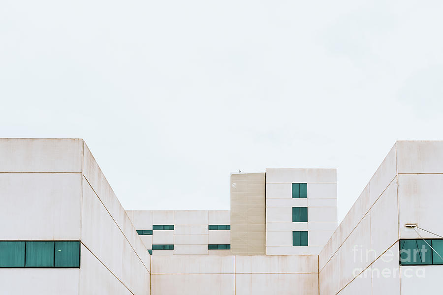 Facade of a white building with simple and minimalist straight l by Joaquin Corbalan