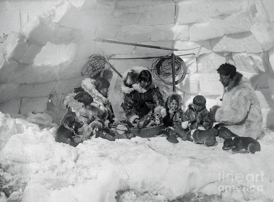 Family Of Eskimos In Igloo Photograph by Bettmann