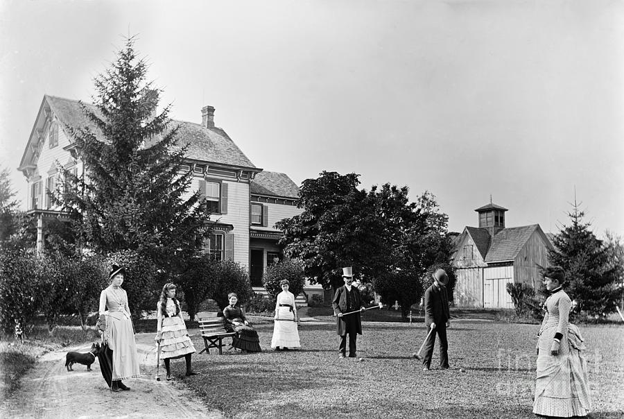 Family Plays Croquet In Front Of Home Photograph by Bettmann