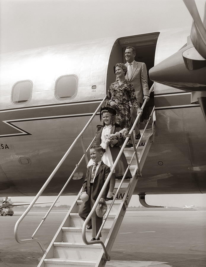 Family Walking Down Airplane Stairs Photograph by H. Armstrong Roberts