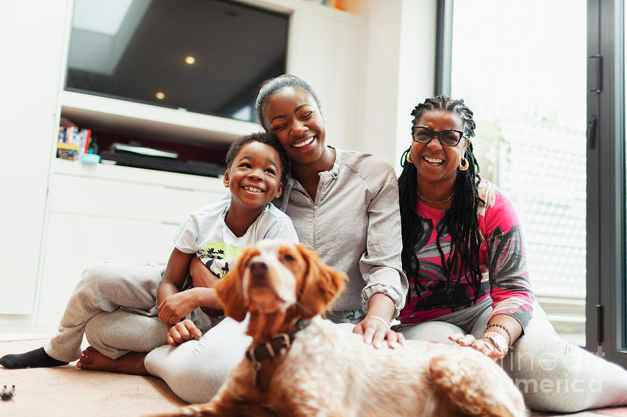 Affection Photograph - Family With Dog On Living Room Floor by Caia Image/science Photo Library
