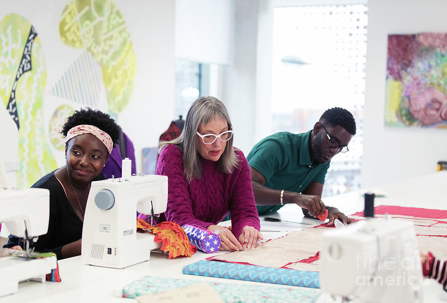 Fashion Designers Working In Studio Photograph By Caia Image Science Photo Library