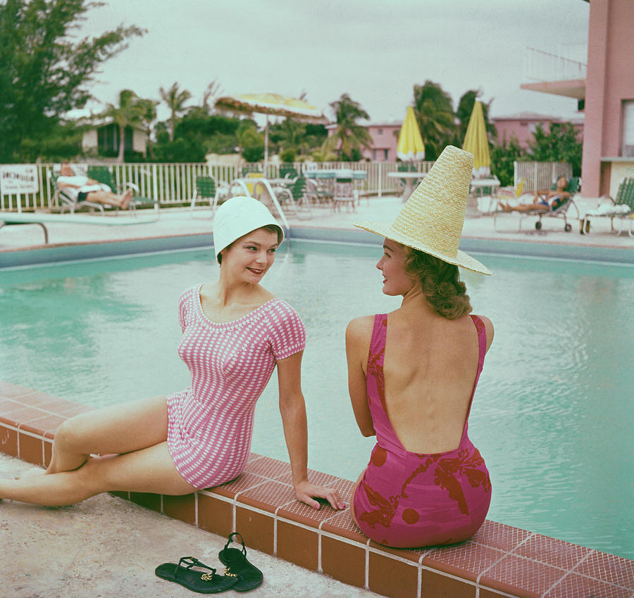 Fashionable Women Lounging At Poolside Photograph by Bettmann