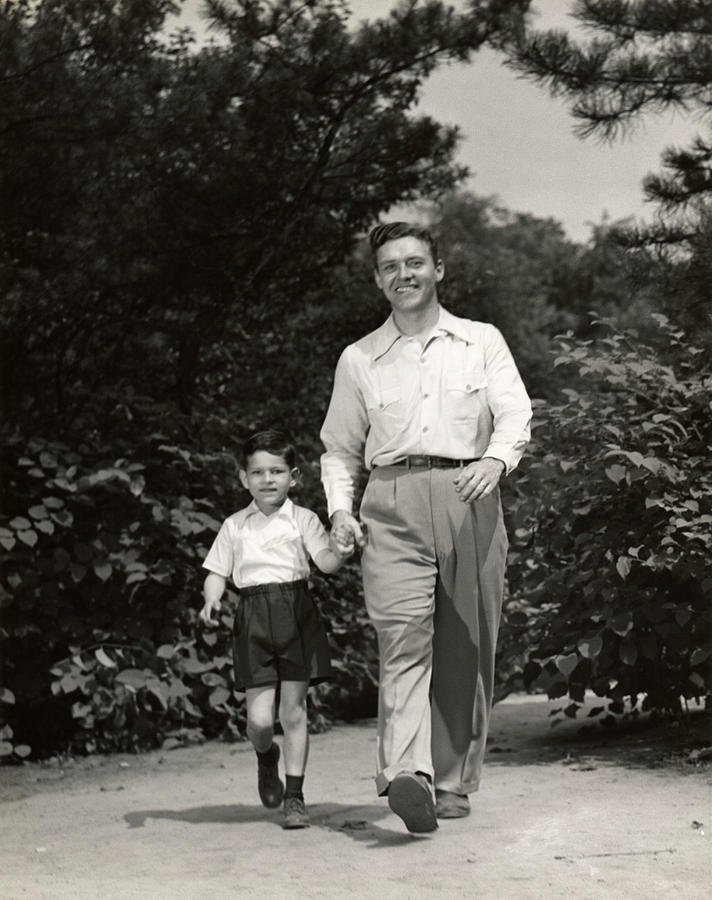 Father Walking With Son Photograph by George Marks