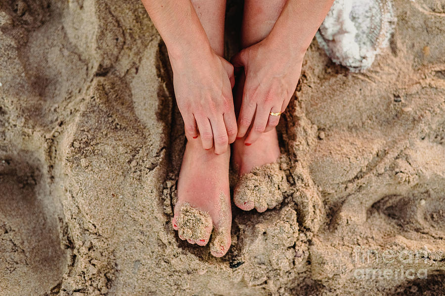 Feet Of Woman In The Sand Of A Beach Photograph