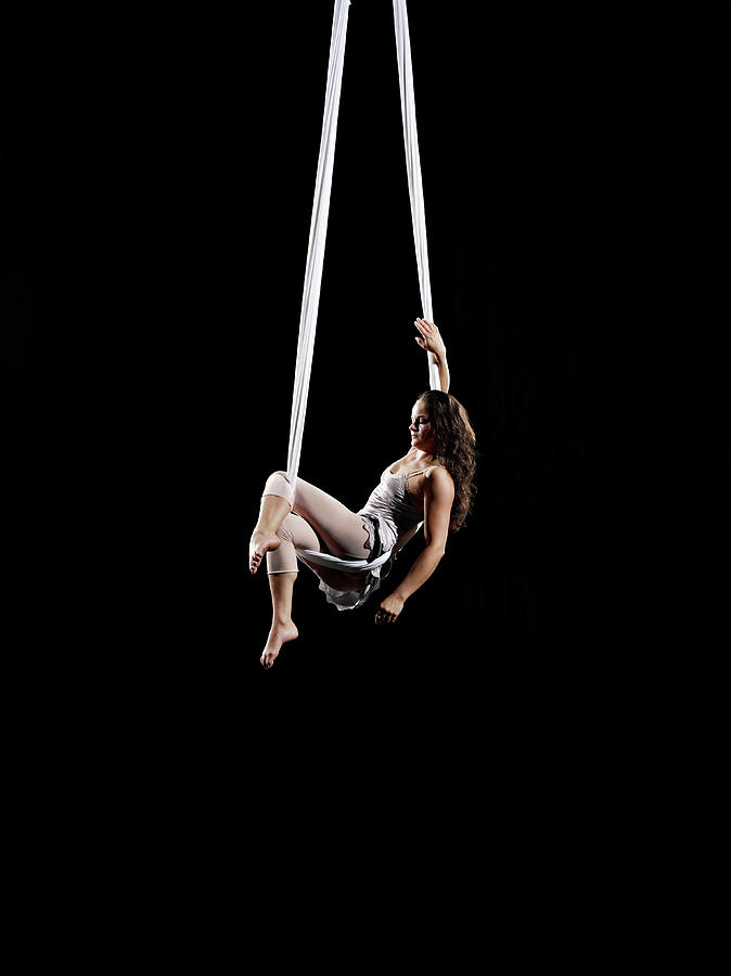Female Aerialist Seated On Suspended Photograph by Thomas Barwick