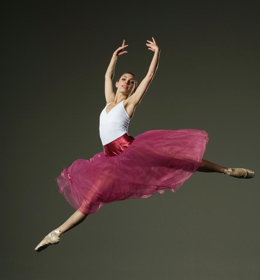Female Ballet Dancer Jumping Photograph by Tetra Images - Erik Isakson