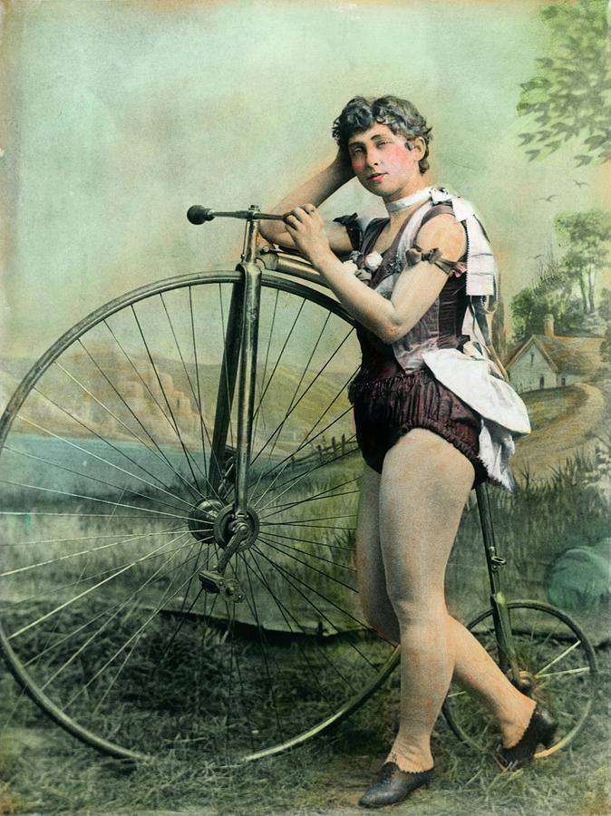 Female Circus Performer With Bicycle Photograph by Bettmann