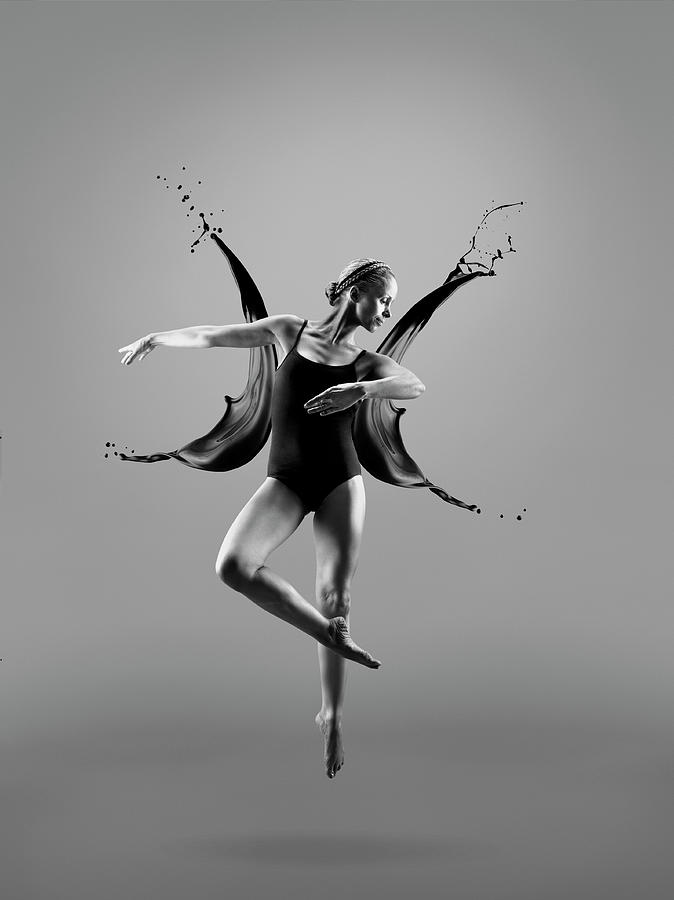 Female Dancer And Liquid Splashes Photograph by Jonathan Knowles