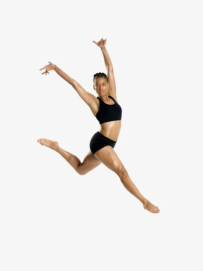 Female Dancer Jumping Photograph by Image Source