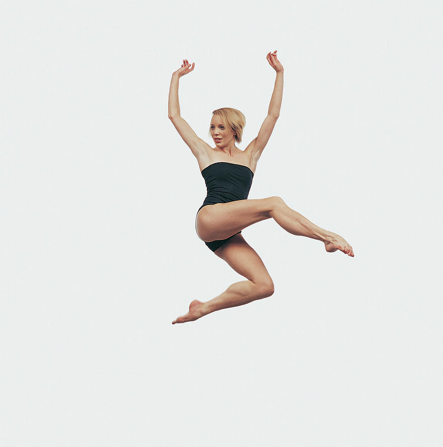 Female Dancer Jumping In Mid Air With Photograph by Chris Nash