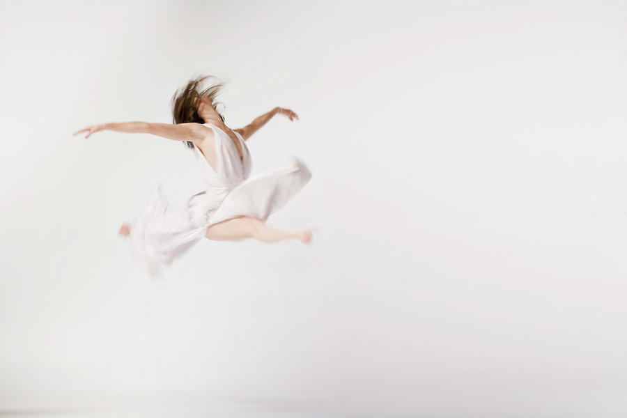 Female Dancer Leaping In Air Blurred Photograph by Mike Powell