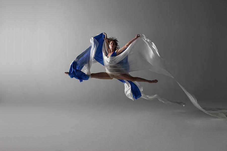 Female Dancer Performing A Grand Jeté Photograph by Nisian Hughes