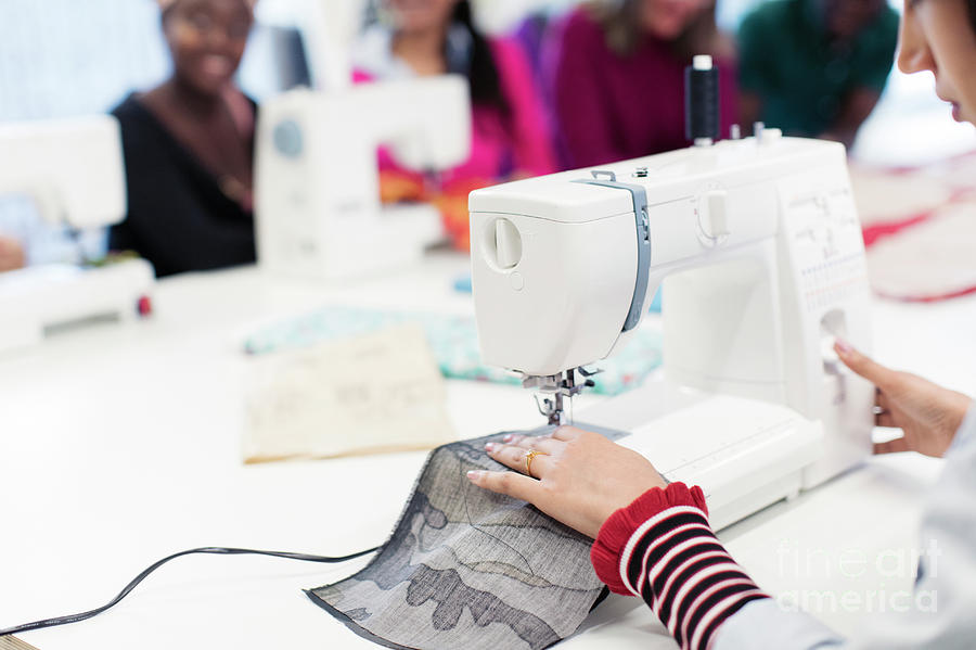 Female Fashion Designer Working At Sewing Machine Photograph By Caia Image Science Photo Library