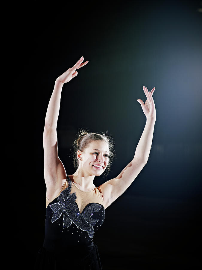 Female Figure Skater Posing With Arms Photograph by Thomas Barwick