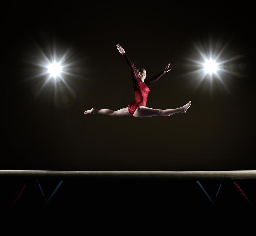 Female Gymnast Doing Mid Air Splits Photograph by Mike Harrington