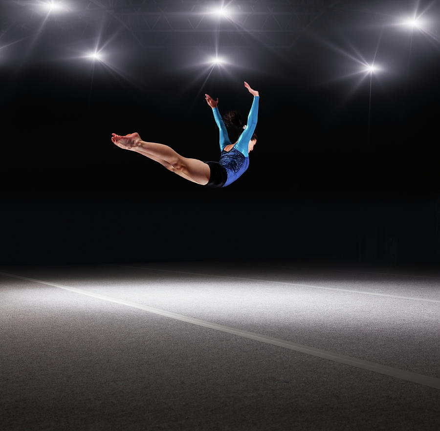 Female Gymnast Jumping Through Air Photograph by Robert Decelis Ltd