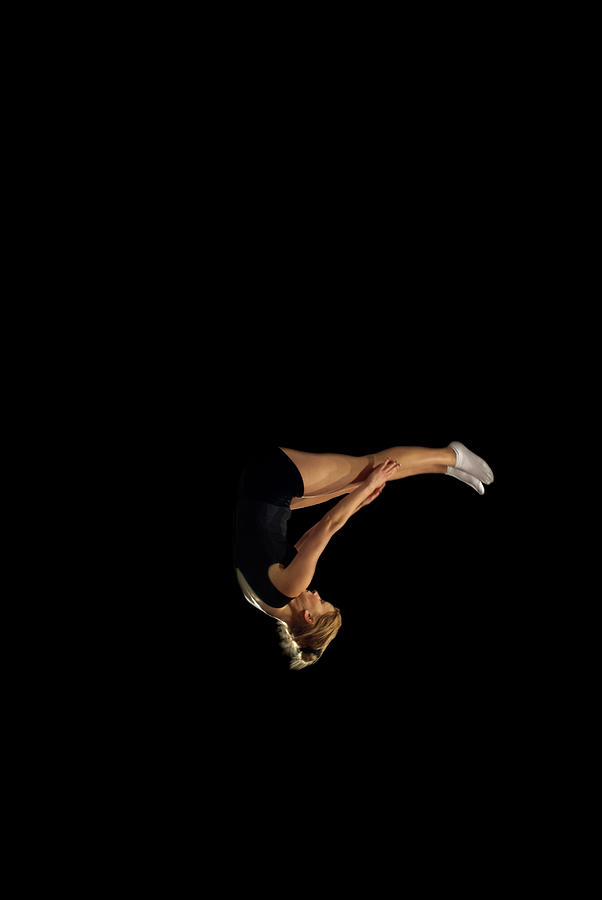 Female Gymnast Upside Down Mid Flight Photograph by Peter Muller