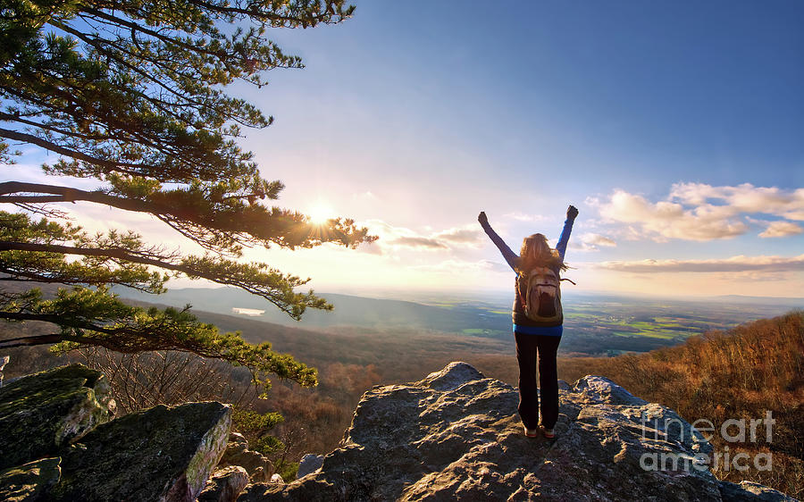 Female Hiker Raising Arms to the sun setting over a beautiful Appalachian vista by Patrick Wolf