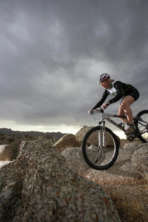 Female Rider Mountain Biking Between Photograph by Thomas Northcut