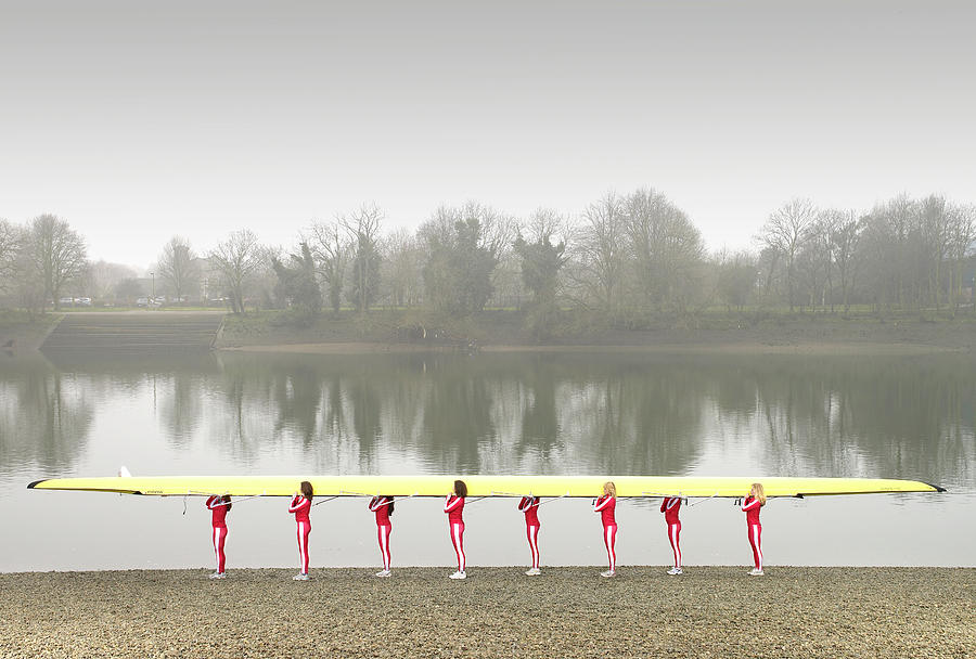 Female Rowers Carrying Scull, Side View Photograph by Adrian Samson