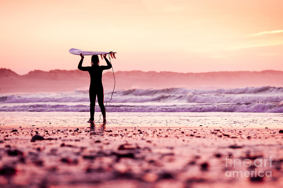 Sunrise Photograph - Female Surfer On The Beach At The Sunset by Iko