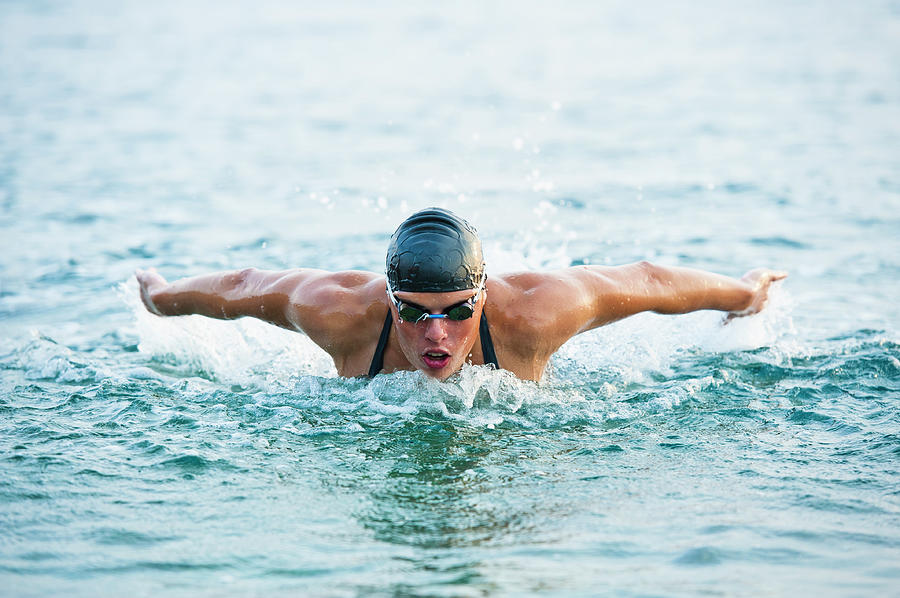 Female Swimmer At Butterfly Stroke In Photograph by Technotr