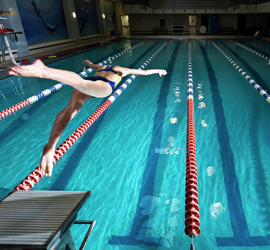 Female Swimmer Diving Into Pool Photograph by Matt Henry Gunther