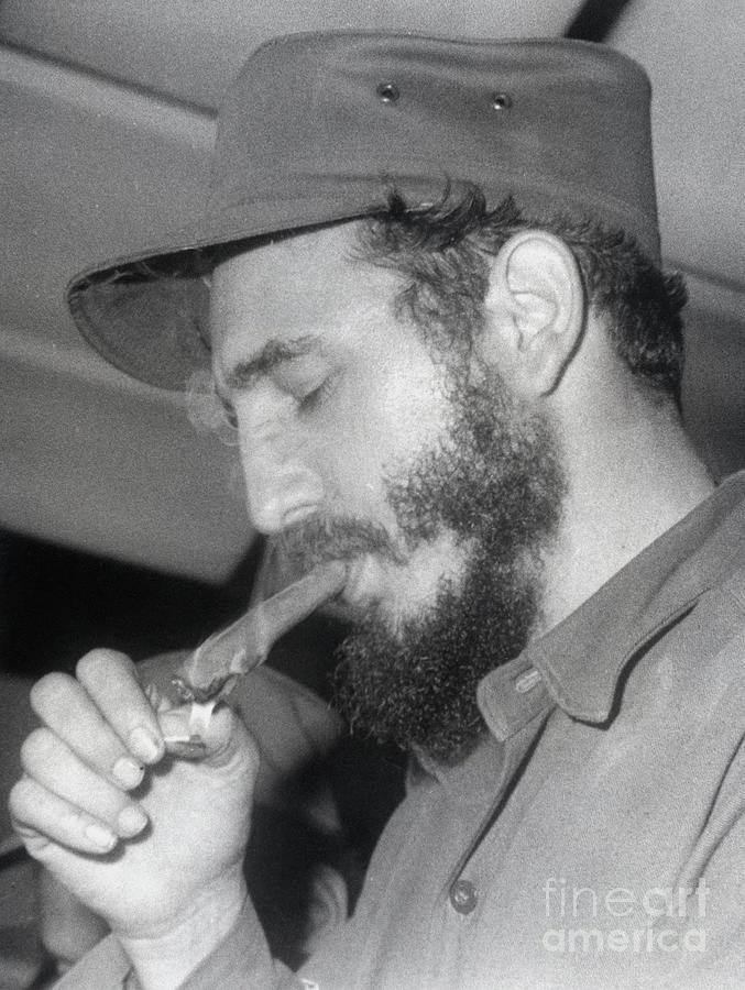 Fidel Castro Lighting A Cigar Photograph by Bettmann